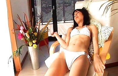 Kana Yume Asian exposes sexy curves in white lingerie at home