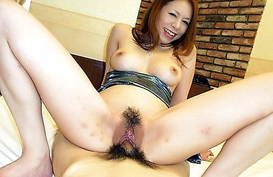 Lovely Japanese model Hiromi exposes her bushy snatch and gives our stunt cock a ride