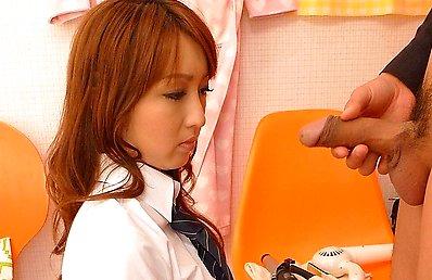 Fat cock rams an Asian schoolgirl's mouth