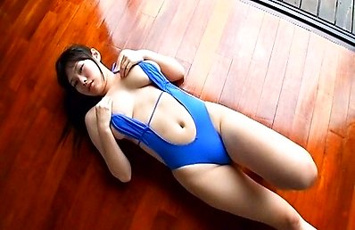 Chika Yuuki Asian fondles huge boobs while posing on the floor