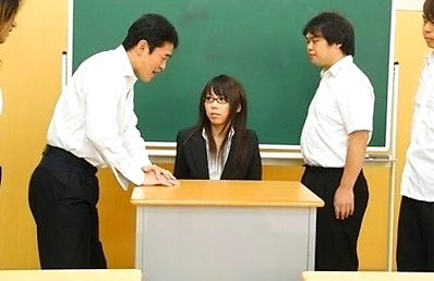Sexy and arousing dark haired teacher Maho Sawai with glasses gets her black suit taken off and her hairy natural slit rammed pretty hard by a group o
