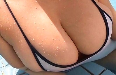 Mai Nishida Asian with huge boobs is happy at and in the pool