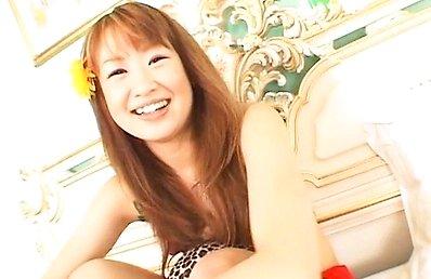 Monna Suzue Asian in Hawaiian mood plays with dick making it hard