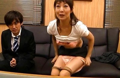Amateur Asian doll spreads legs and rubs her slit at interview